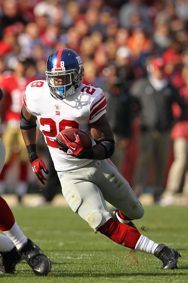 SAN FRANCISCO, CA - NOVEMBER 13: D.J. Ware #28 of the New York Giants runs with the ball against the San Francisco 49ers at Candlestick Park on November 13, 2011 in San Francisco, California. (Photo by Ezra Shaw/Getty Images)