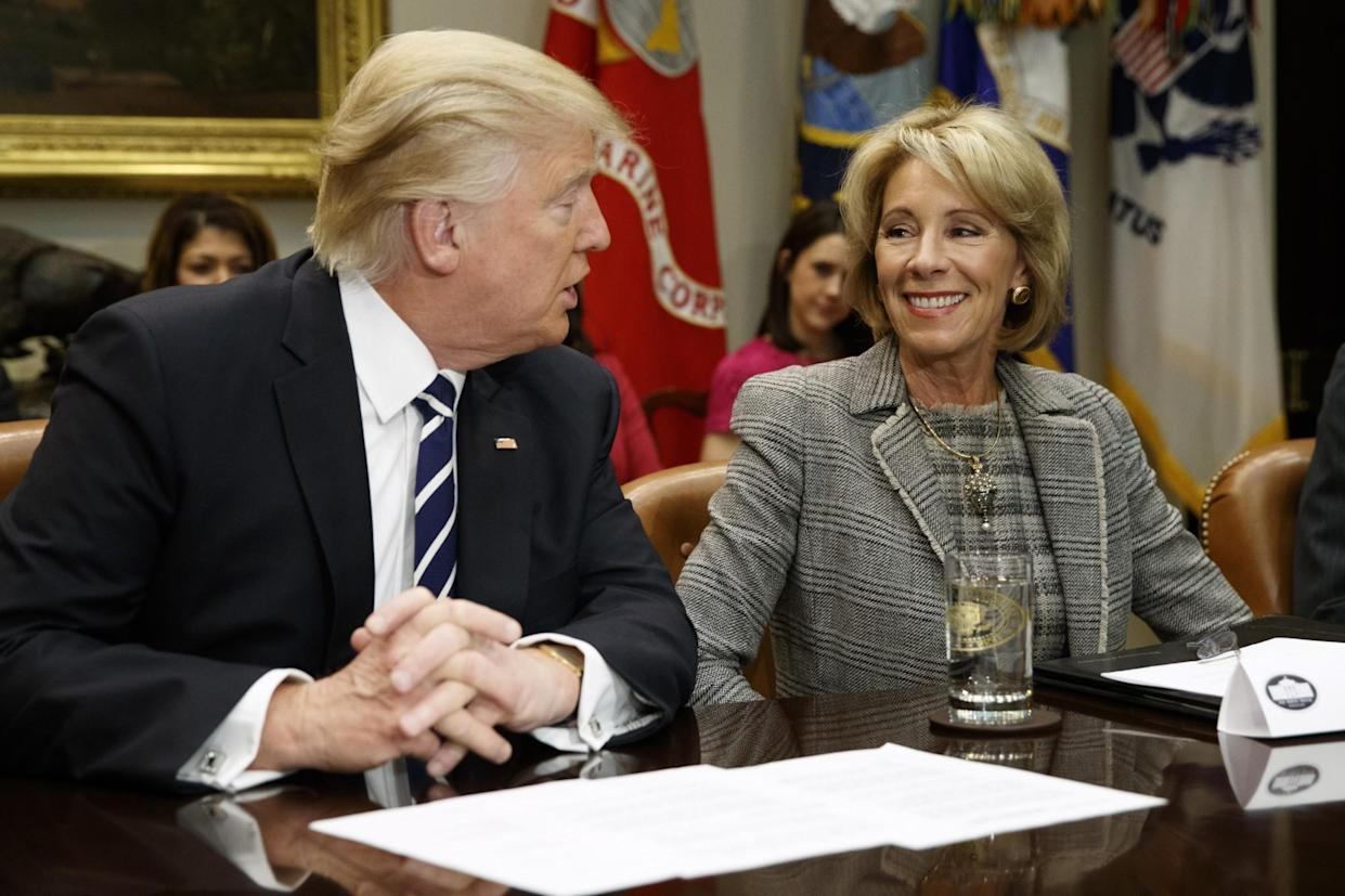 President Trump talks to Education Secretary Betsy DeVos in the Roosevelt Room of the White House in Washington on Feb. 14, 2017. Even as fierce political battles about school choice rage in Washington, most Americans know little about charter schools or private school voucher programs. (Photo: Evan Vucci/AP)