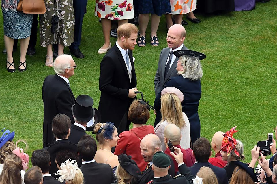 Britain's Prince Harry, Duke of Sussex meets guests at the Queen's Garden Party in Buckingham Palace, central London on May 29, 2019. (Photo by Stuart C. Wilson / POOL / AFP)        (Photo credit should read STUART C. WILSON/AFP via Getty Images)