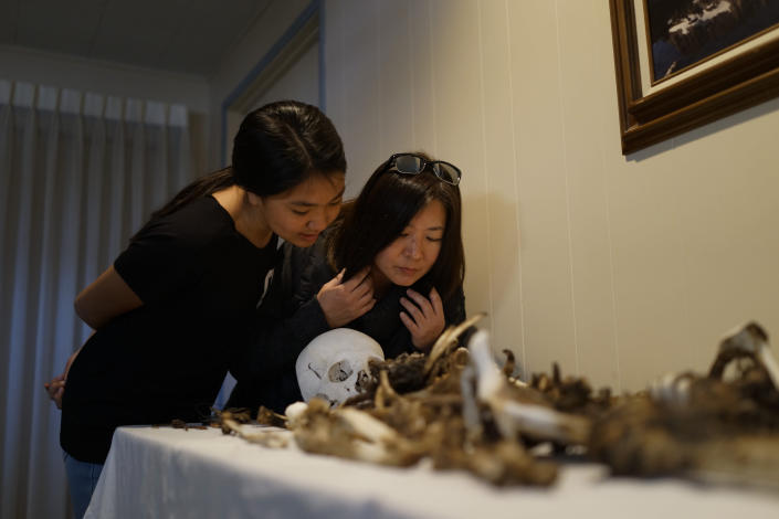 Lori Matsumura, right, and her niece, Lilah Matsumura, look at the bones of their ancestor, Giichi Matsumura, at Brune Mortuary in Bishop, Calif., Monday, Feb. 17, 2020. Giichi Matsumura was a prisoner at the Manzanar internment camp during World War II and died on a hike in the Sierra in the waning days of the war in August 1945. Hikers discovered his mountainside grave and unearthed the skeleton in 2019, leading authorities to retrieve the bones and return them to the Matsumura family. (AP Photo/Brian Melley)