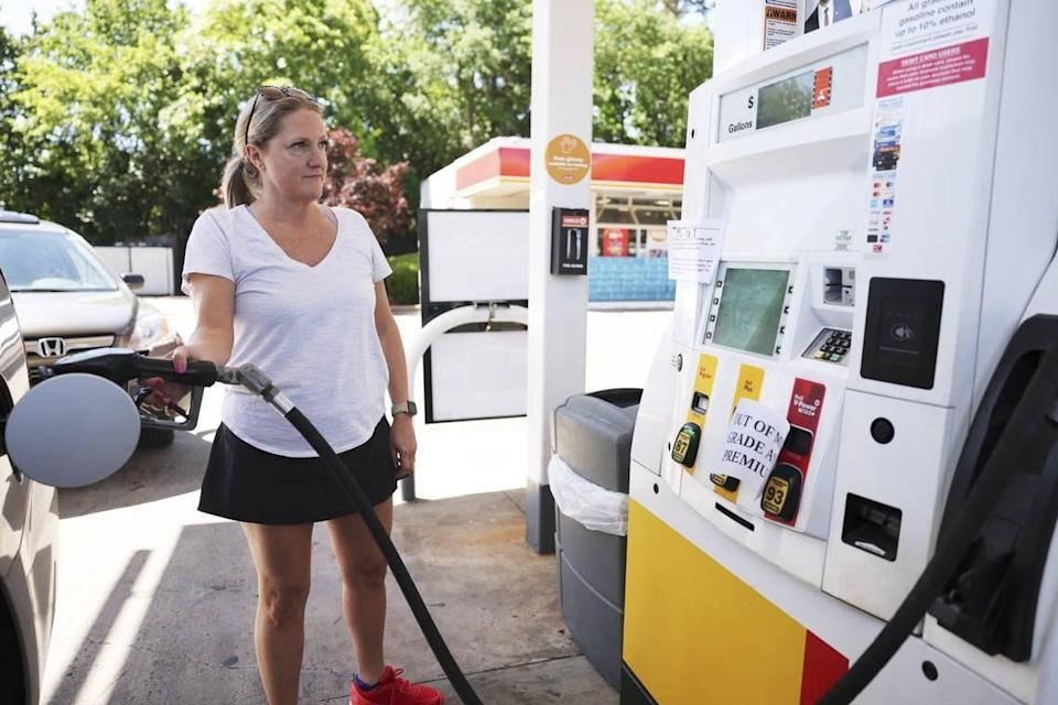 Amy Williams gets gas at the Circle K on Randolph Road in Charlotte, N.C., on Thursday, May 13, 2021. Price per gallon of Regular gas is $2.89.