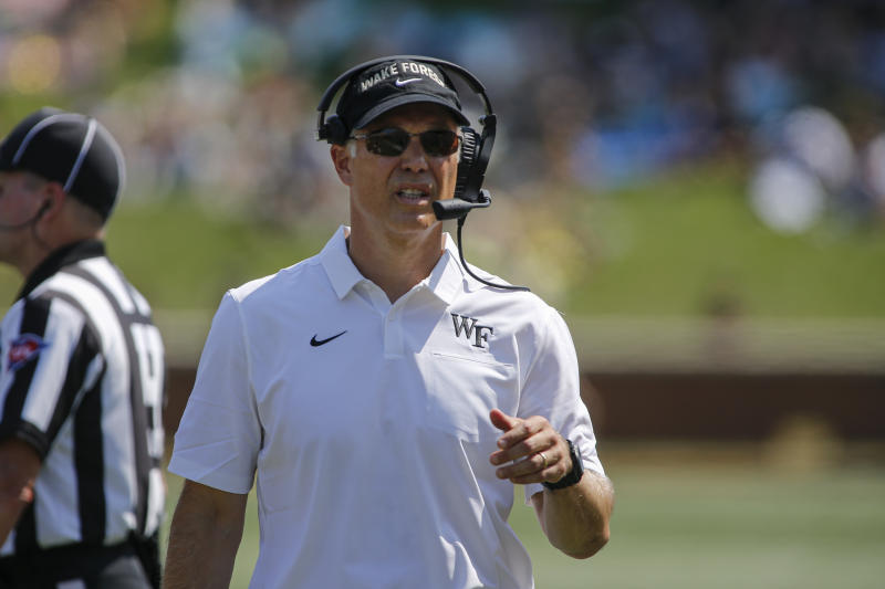 Wake Forest head coach Dave Clawson walks on the sideline as his team plays Elon in the first half of an NCAA college football game in Winston-Salem, N.C., Saturday, Sept. 21, 2019. Wake Forest won 49-7. (AP Photo/Nell Redmond)
