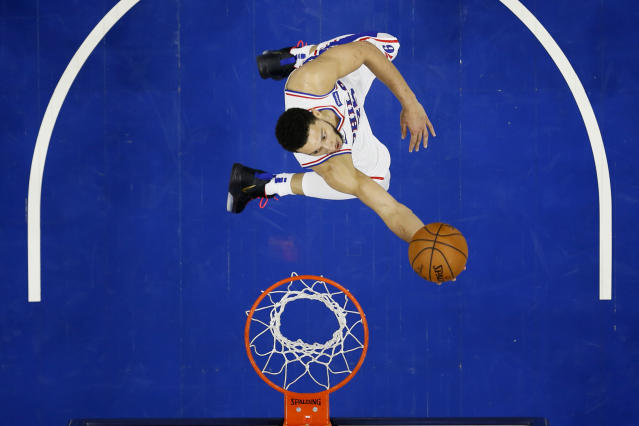 Philadelphia 76ers' Ben Simmons goes up for a shot during the first half of an NBA basketball game against the Toronto Raptors, Sunday, Dec. 8, 2019, in Philadelphia. (AP Photo/Matt Slocum)