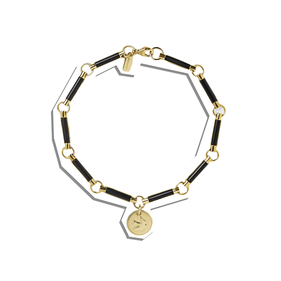 """The sparrow emblem on this bracelet offers the coded message of """"hope."""" It's a piece we know dad will treasure for a lifetime. $2520, Mr. Porter. <a href=""""https://www.mrporter.com/en-us/mens/product/foundrae/accessories/bracelets/spero-18-karat-gold-onyx-bracelet/19971654706595547"""" rel=""""nofollow noopener"""" target=""""_blank"""" data-ylk=""""slk:Get it now!"""" class=""""link rapid-noclick-resp"""">Get it now!</a>"""