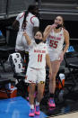 Maryland's Katie Benzan (11) and Ashley Owusu (15) celebrate on the sideline during the second half of an NCAA college basketball semifinal game against Northwestern at the Big Ten Conference tournament, Friday, March 12, 2021, in Indianapolis. Maryland won 85-52. (AP Photo/Darron Cummings)
