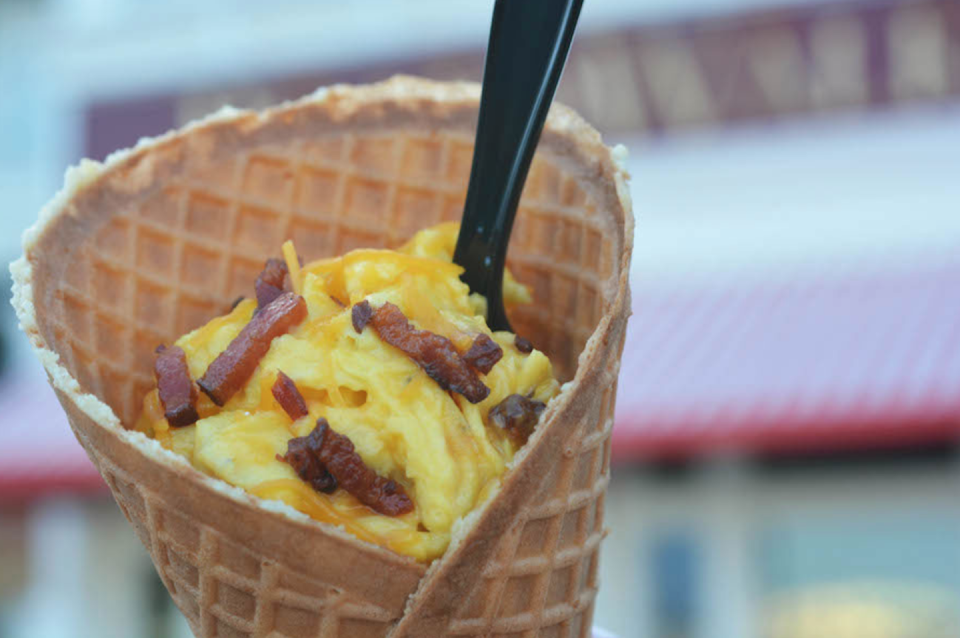 """<p>Food like this is always fun. Once you finish the eggs, you can start eating the cone. No utensils are required at <a href=""""https://disneyworld.disney.go.com/destinations/boardwalk/"""" rel=""""nofollow noopener"""" target=""""_blank"""" data-ylk=""""slk:Disney's Boardwalk"""" class=""""link rapid-noclick-resp"""">Disney's Boardwalk</a>!</p>"""