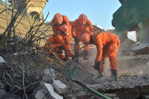 Rescuers have used concrete cutters and excavators to claw through the rubble of the collapsed Lombok mosque