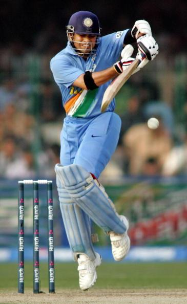 Lahore, PAKISTAN:  Indian cricketer Sachin Tendulkar plays a stroke during the third One Day International match between Pakistan and India at The Gaddafi Cricket Stadium in Lahore, 13 February 2006.   Pakistan scored 288 runs for the loss of eight wickets in their alotted 50 overs.  India have scored 126 runs for the loss of three wicket in 25 overs.AFP PHOTO/Aamir QURESHI  (Photo credit should read AAMIR QURESHI/AFP/Getty Images)