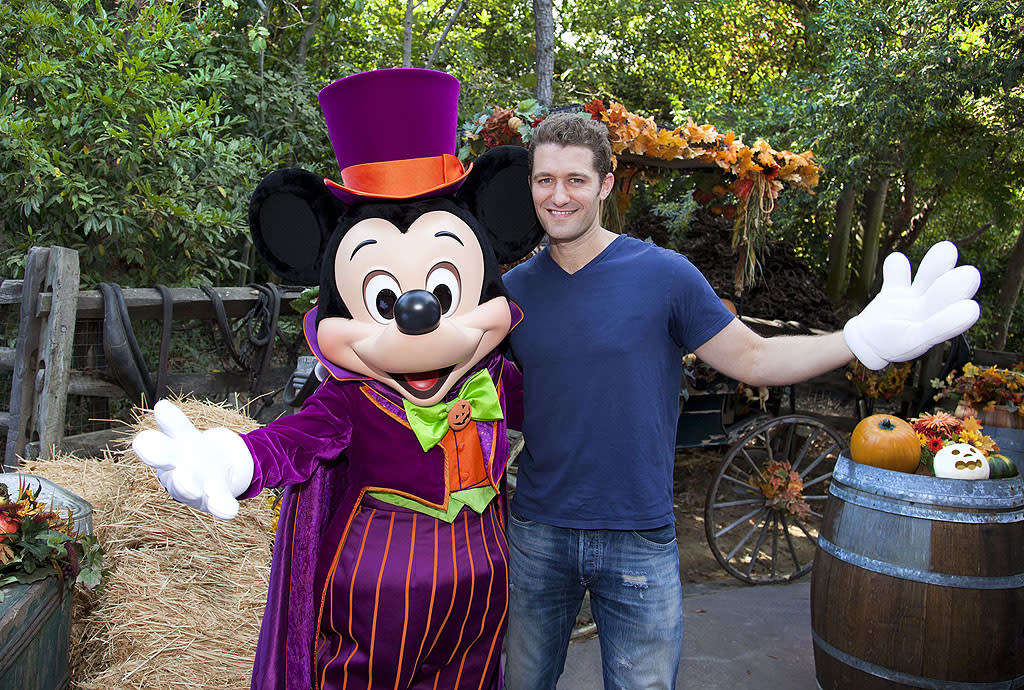 """Glee"" star Matthew Morrison poses with a Halloween-clad Mickey Mouse at Disneyland Park in Anaheim, California. In addition to celebrating Halloween at the park, Morrison also marked the visit with an early celebration of his October 30 birthday.  