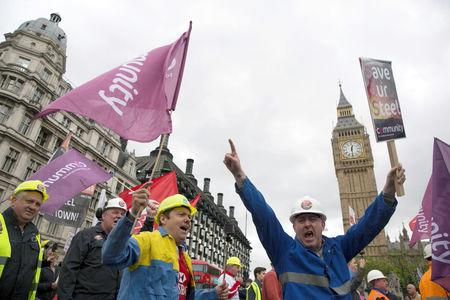 Steel workers take part in a demonstration asking for government help for the British steel industry in London