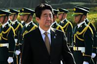 """Japanese Prime Minister Shinzo Abe hailed the landmark agreement on wartime sex slaves and welcomed a """"new era"""" of ties with South Korea (AFP Photo/Yoshikazu Tsuno )"""