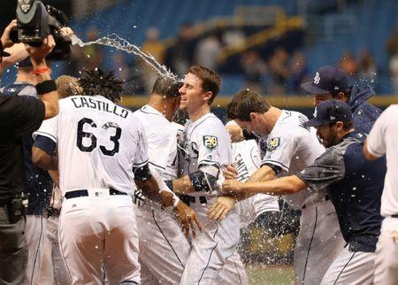 Jun 13, 2018; St. Petersburg, FL, USA; Tampa Bay Rays third baseman Matt Duffy (5) gets a gatorade bath as he is congratulated by teammates after hitting the game winning RBI single to beat the Toronto Blue Jays at Tropicana Field. Mandatory Credit: Kim Klement-USA TODAY Sports