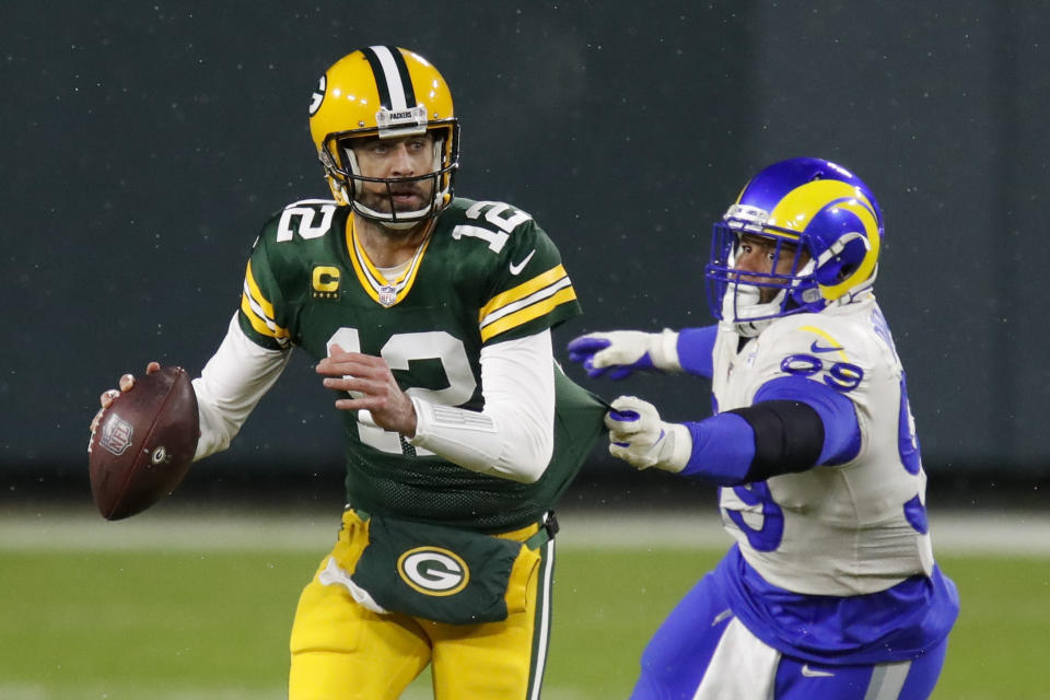 Aaron Donald couldn't chase down Aaron Rodgers on a play in the first half of Saturday's loss. (AP Photo/Matt Ludtke)