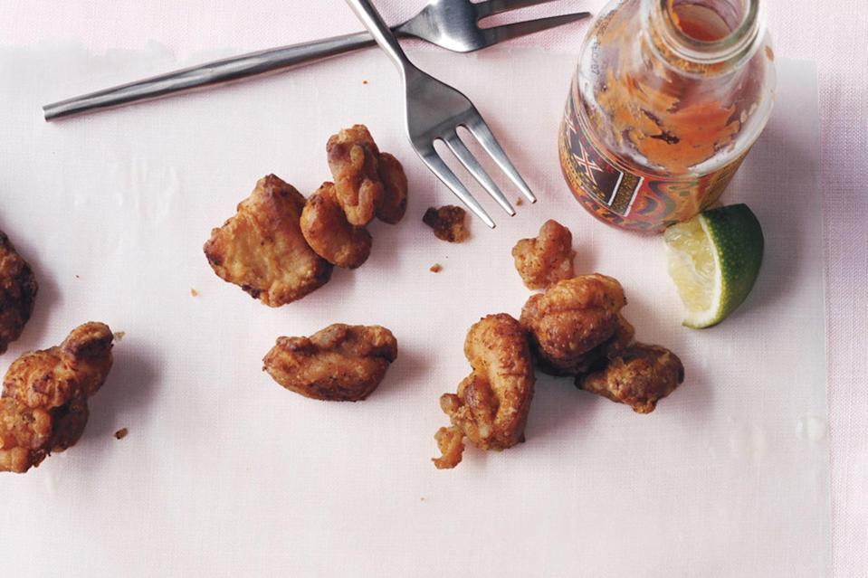 """These irresistible nuggets, a specialty of Puerto Rico and the Dominican Republic, come out wonderfully when you start with boneless chicken thighs. A marinade of rum, lime juice, and soy sauce provides lots of savory flavor. <a href=""""https://www.epicurious.com/recipes/food/views/fried-chicken-bites-239956?mbid=synd_yahoo_rss"""" rel=""""nofollow noopener"""" target=""""_blank"""" data-ylk=""""slk:See recipe."""" class=""""link rapid-noclick-resp"""">See recipe.</a>"""