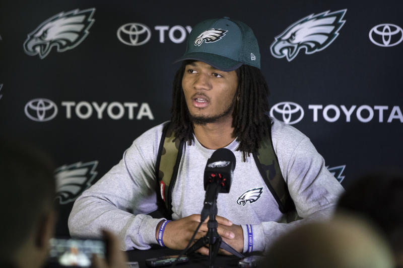 "FILE - In this May 12, 2017 file photo, Philadelphia Eagles' Sidney Jones speaks with members of the media during NFL football rookie minicamp at the team's training facility in Philadelphia. A group of fans have helped return  Jones' lost cellphone during the team's Super Bowl victory parade, but not before taking a selfie. Jones was with several of his teammates in Philadelphia on Thursday, Feb. 8, 2018,  as they celebrated the Eagles' 41-33 victory over the favored New England Patriots when his phone reportedly fell out of his back pocket. A photo appeared on the player's verified Instagram page shortly afterward that showed several smiling fans with the caption, ""Guess who dropped their phone at the parade!"" The fans promised to return it.(AP Photo/Matt Rourke, File)"