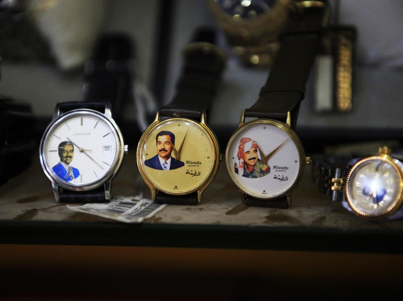 In this Sunday, April 7, 2013 photo, watches with image of the former dictator Saddam Hussein are on display at a souvenirs shop in downtown Baghdad, Iraq. Ten years ago, a statue fell in Paradise Square. Joyful Iraqis helped by a U.S. Army tank retriever pulled down their longtime dictator, cast as 16 feet of bronze. The scene broadcast live worldwide became an icon for a war, a symbol of final victory over Saddam Hussein. But for the people of Baghdad, it was only the beginning. The toppling of the statue on April 9, 2003, remains a potent symbol that has divided Iraqis ever since. (AP Photo/ Karim Kadim)