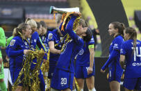 Chelsea's Sam Kerr, center, celebrates with the trophy after winning the FA Women's League Cup final soccer match against Bristol City at Vicarage Road, London, Sunday March 14, 2021. (Mike Egerton/PA via AP)