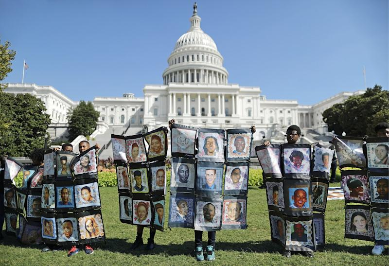 In September, students displayed images of victims at a gun-violence rally in Washington, D.C.