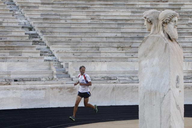 Jurgen Mennel from Germany runs inside the Panathenean stadium, where the first modern Olympics were held in 1896, in Athens, October 21, 2010. Greece's culture ministry has honoured long distance runner Mennel, who has ran from Strasbourg to Athens in honour of the 2,500th Anniversary of the Battle of Marathon, with a ceremony at Greece's ancient Panathenean stadium. REUTERS/John Kolesidis