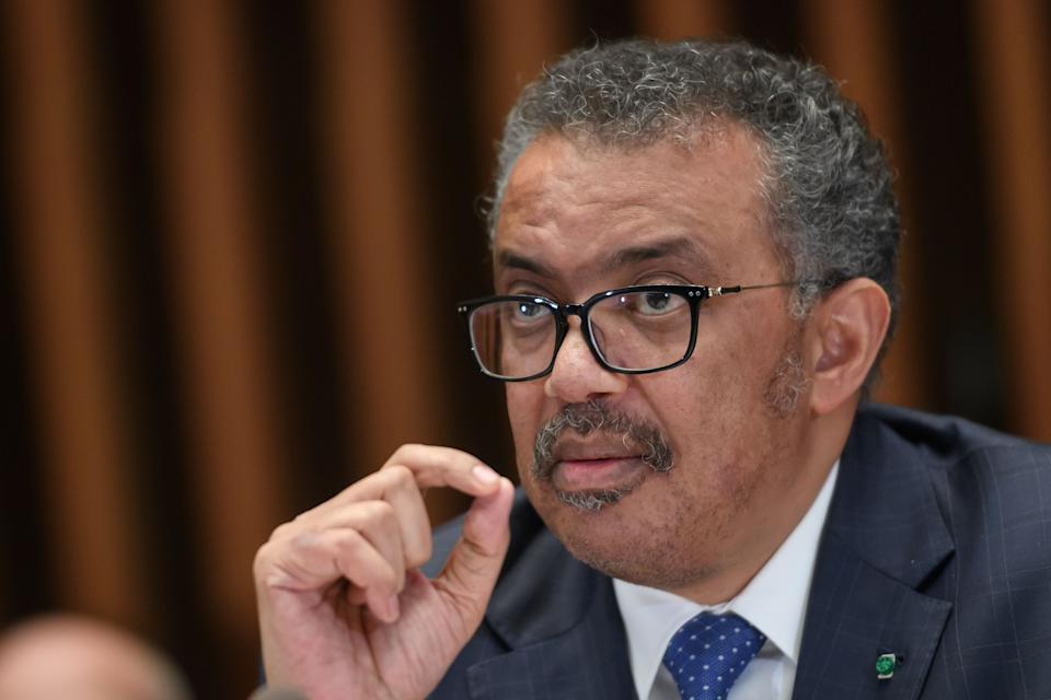 "World Health Organization (WHO) Director-General Tedros Adhanom Ghebreyesus attends a combined news conference following a two-day international conference on COVID-19 coronavirus vaccine research and a meeting to decide whether Ebola in DR Congo still constitutes health emergency of international concern on January 12, 2020 in Geneva. - The UN health agency on February 12 cautioned it was ""way too early"" to say whether COVID-19 might have peaked or when it might end, following a drop in the number of new cases. (Photo by Fabrice COFFRINI / AFP) (Photo by FABRICE COFFRINI/AFP via Getty Images)"