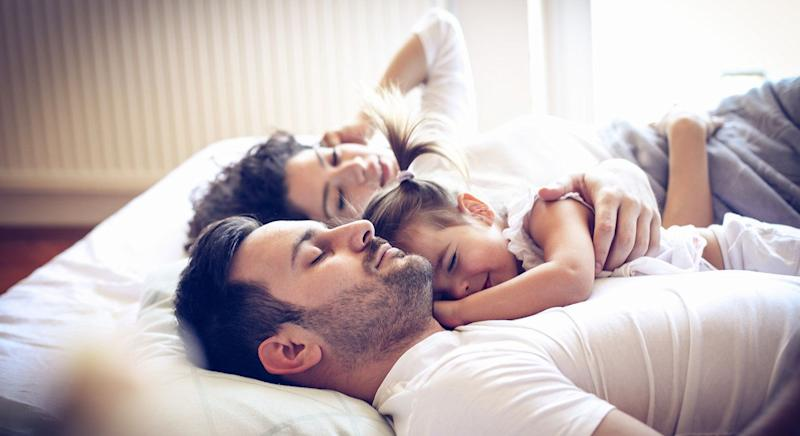 A mum has discovered her son regularly shares a bed with her ex and his new girlfriend. [Photo: Getty]
