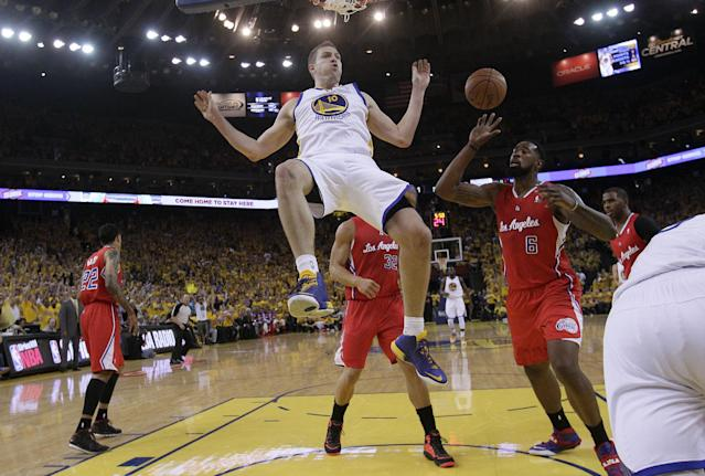 Golden State Warriors power forward David Lee (10) drops from the rim after dunking against the Los Angeles Clippers during the first half of Game 6 of an opening-round NBA basketball playoff series in Oakland, Calif., Thursday, May 1, 2014. (AP Photo/Marcio Jose Sanchez)