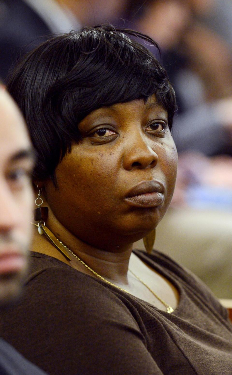 Ursula Ward, Odin Lloyds mother sits during football player Aaron Hernandez's murder trial at Bristol County Superior Court in Fall River, Massachusetts February 11, 2015. REUTERS/Ted Fitzgerald/Pool (UNITED STATES - Tags: CRIME LAW SPORT FOOTBALL)