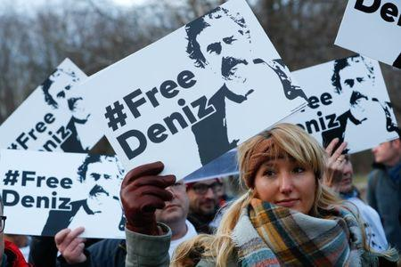 Protestors attend a demonstration to support arrested German-Turkish journalist Deniz Yucel