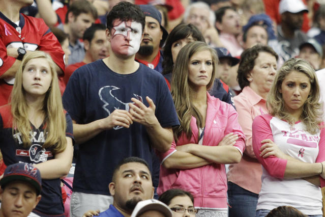 Houston Texans fans watch after quarterback Matt Schaub was injured during the third quarter of an NFL football game against the St. Louis Rams, Sunday, Oct. 13, 2013, in Houston, Texas. (AP Photo/Patric Schneider)