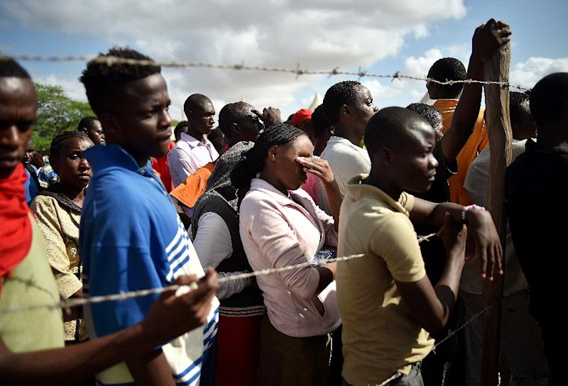 Kenyan students evacuated from Moi University after it was targeted in a deadly attack by Shebab militants listen to an address by Interior Minister Joseph Ole Nkaissery in Garissa, on April 3, 2015 (AFP Photo/Carl de Souza)