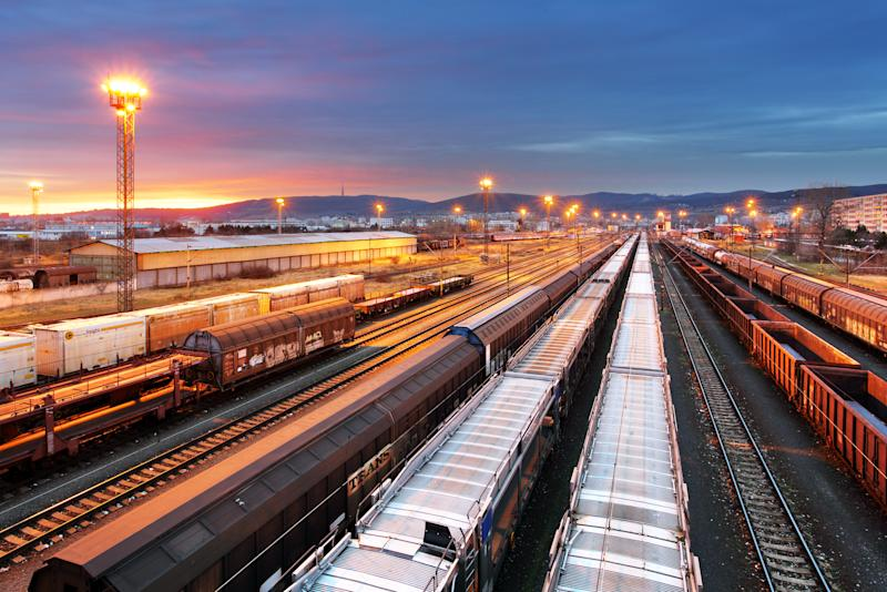 A contemporary train yard at dusk.