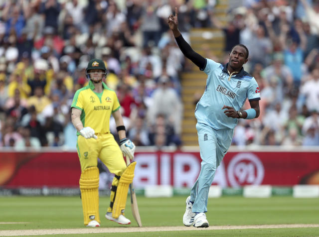 England's Jofra Archer, right, celebrates the dismissal of Australia's Glenn Maxwell during the Cricket World Cup semi-final match between England and Australia at Edgbaston in Birmingham, England, Thursday, July 11, 2019. (AP Photo/Aijaz Rahi)