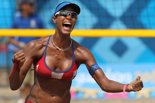 PUERTO VALLARTA, MEXICO - OCTOBER 21: Yarleen Santiago of Puerto Rico celebrates the Bronze Medal win against the USA at the Beach Volleyball Stadium on October 21, 2011 in Guadalajara, Mexico. (Photo by Al Bello/Getty Images)