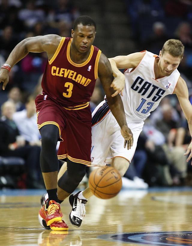 Charlotte Bobcats guard Luke Ridnour, right, fouls Cleveland Cavaliers guard Dion Waiters during the first half of an NBA basketball game in Charlotte, N.C., Friday, March 7, 2014. (AP Photo/Nell Redmond)