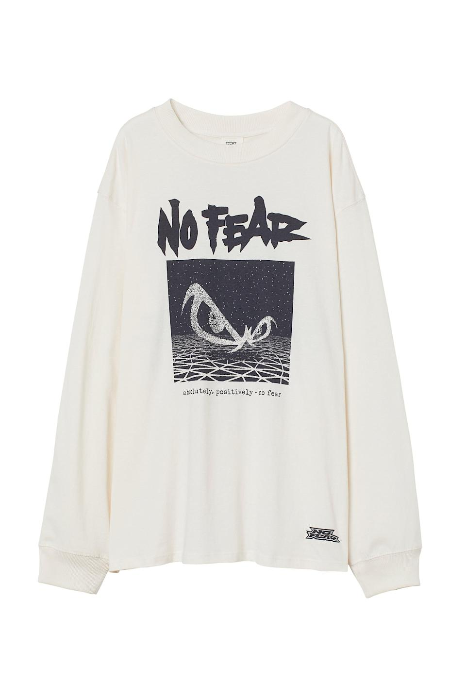 <p>Not only is this <span>No Fear x H&amp;M Long-sleeved Jersey Top</span> ($15) super comfortable, there's also a great graphic on the back. Wear this with loose pants or cute shorts and boots.</p>
