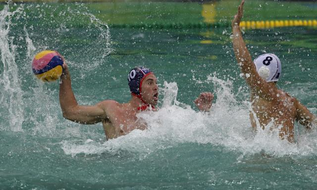 "<a class=""link rapid-noclick-resp"" href=""/olympics/rio-2016/a/1105966/"" data-ylk=""slk:Bret Bonanni"">Bret Bonanni</a> of the U.S. men's water polo team takes a shot against France in Rio's green water. (Getty)"