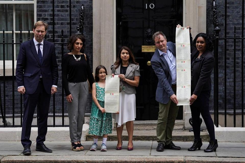 Richard Ratcliffe, second right, and his daughter Gabriella and supporters hand in a petition to 10 Downing Street to mark the 2,000th day of Ms Zaghari-Ratcliffe's detention (Kirsty O'Connor/PA) (PA Wire)