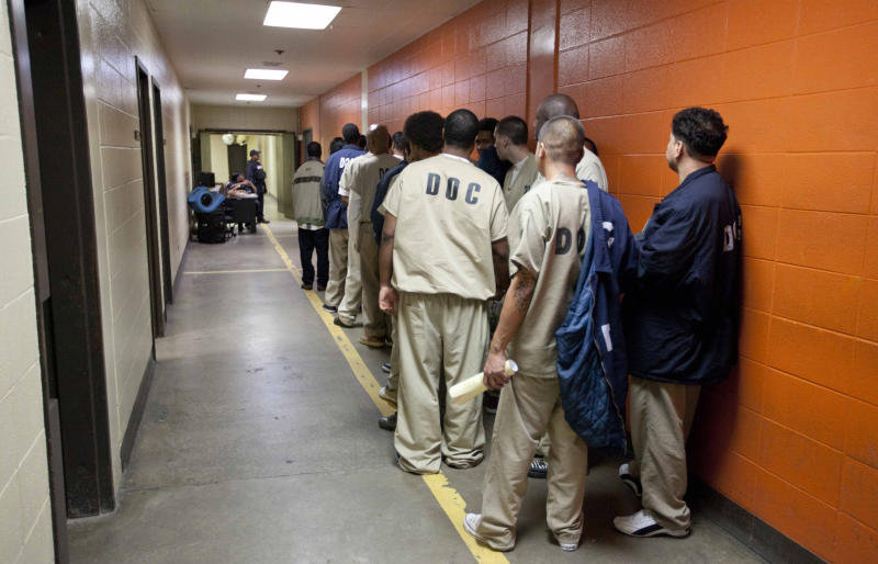 FILE - In this Sept. 29, 2011 photo, inmates at the Cook County Jail in Chicago, the second largest county jail in the nation, line up to be processed for release. Cook County Commissioners have passed an ordinance this month that orders the jail not to hold illegal immigrants until Immigration and Customs Enforcement, ICE officers can pick them up. (AP Photo/M. Spencer Green, File)