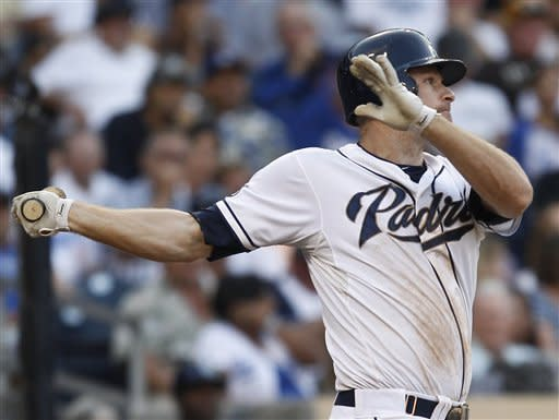 San Diego Padres' Chase Headley watches his long double to centerfield that drove in his 109th run of the year during seventh inning of a baseball game against the Los Angeles Dodgers Wednesday, Sept. 26, 2012 in San Diego. Headley started the day tied with Milwaukee Brewers' Ryan Braun with 108 RBIs. (AP Photo/Lenny Ignelzi)
