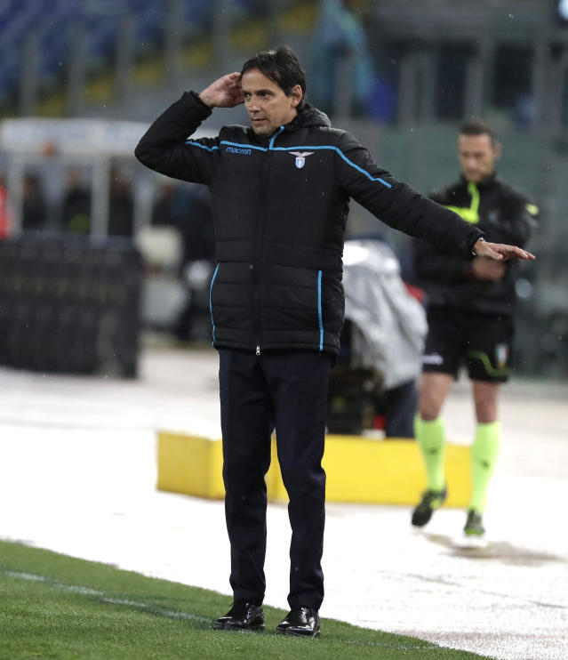 Lazio coach Simone Inzaghi gives directions to players during an Italian Serie A soccer match between Lazio and Bologna, at the Olympic stadium in Rome, Monday, May 20, 2019. (AP Photo/Andrew Medichini)