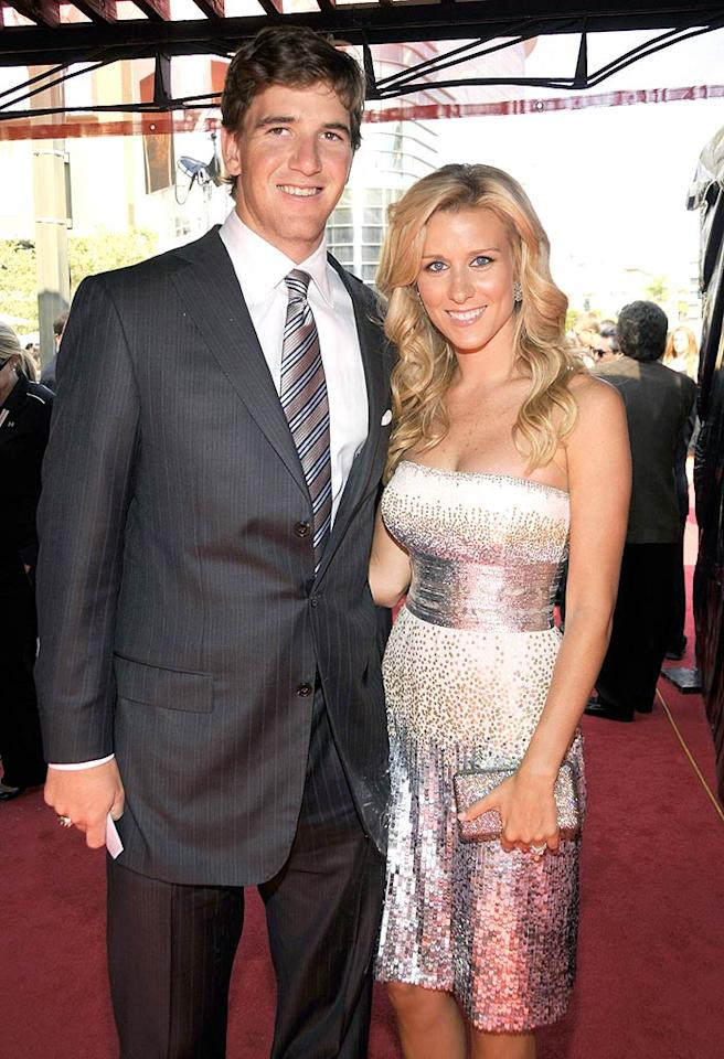 "Superbowl MVP Eli Manning may not be traditionally handsome, but he has a boyish charm that women love. Just ask his wife Abby McGrew! Kevin Mazur/<a href=""http://www.wireimage.com"" target=""new"">WireImage.com</a> - July 16, 2008"