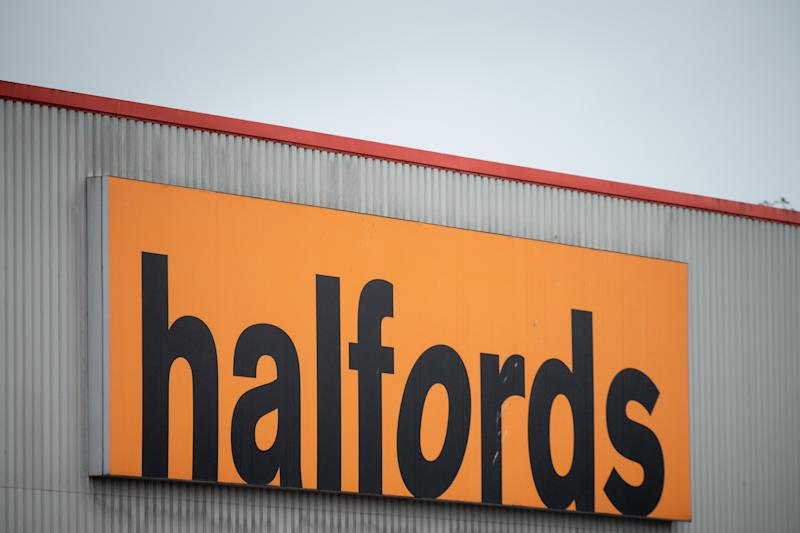 CARDIFF, WALES - JULY 27: A close-up of a Halfords store sign on July 27, 2020 in Cardiff, Wales. Many UK businesses are announcing job losses due to the effects of the coronavirus pandemic and lockdown. (Photo by Matthew Horwood/Getty Images)