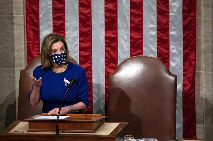 House Speaker Nancy Pelosi, D-Calif., speaks in the House chamber after they reconvened for arguments over the objection of certifying Arizona's Electoral College votes in November's election.