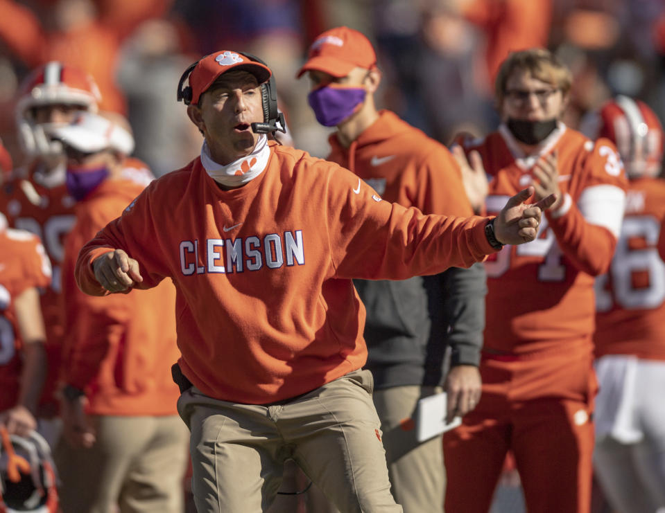 Clemson head coach Dabo Swinney talks with players during the second half of an NCAA college football game Saturday, Oct. 31, 2020, in Clemson, S.C. (Josh Morgan/Pool Photo via AP)