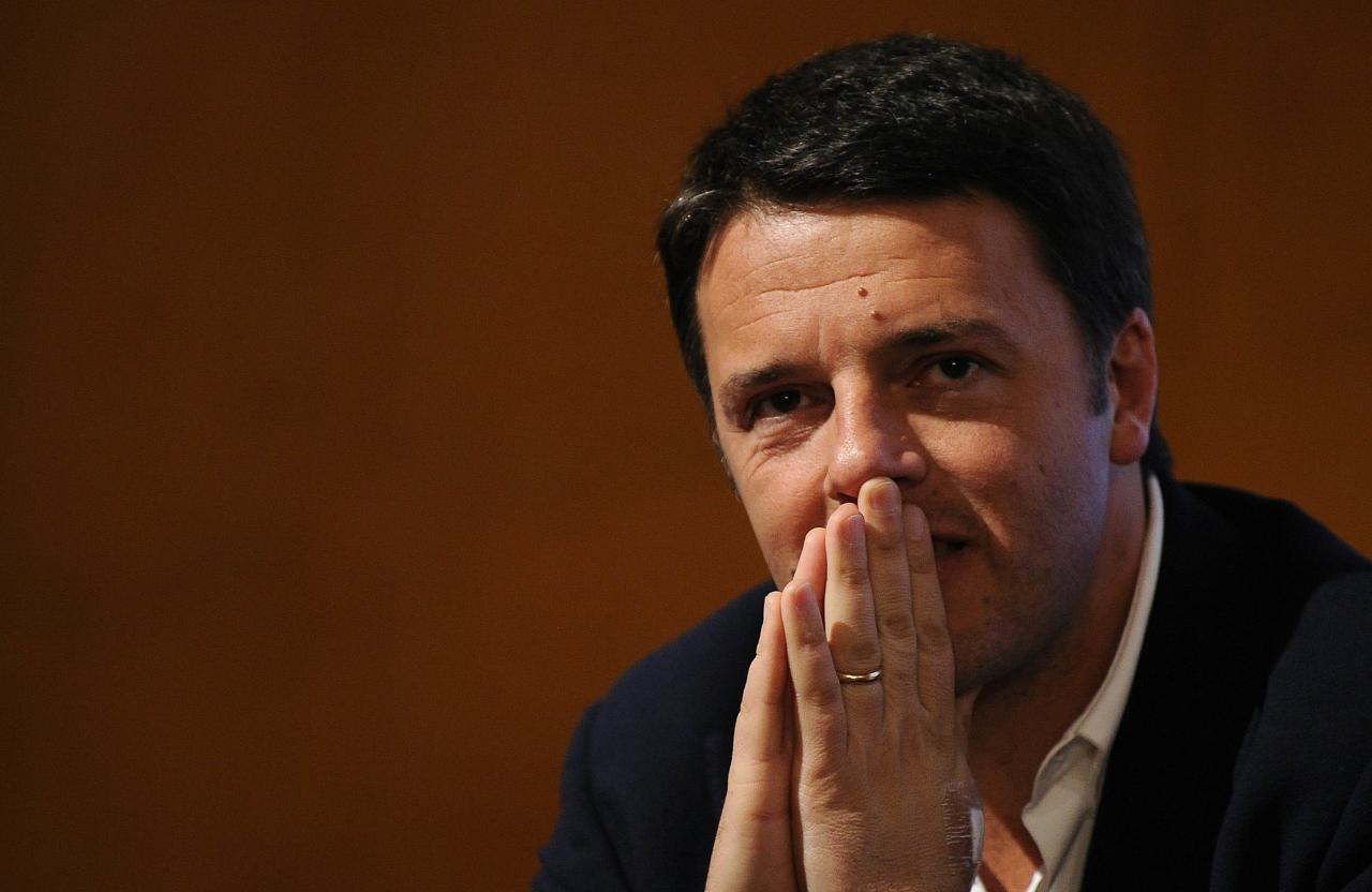 Florence mayor Matteo Renzi looks on during a political meeting in Turin December 6, 2013. The 38-year-old Renzi is overwhelming favourite to win Sunday's primary to appoint a new secretary of Italy's centre-left Democratic Party (PD) to lead the largest party in Letta's government. REUTERS/Giorgio Perottino (ITALY - Tags: POLITICS)