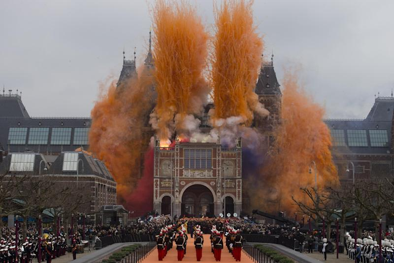"""Fireworks are seen during the official opening of the renovated Rijksmuseum in Amsterdam, Netherlands, Saturday April 13, 2013. The Rijksmuseum, home of Rembrandt's """"The Night Watch"""" and other national treasures reopens its doors to the public after a decade-long renovation. The first day, Saturday April 13, admissions are free and the museum stays open until midnight. (AP Photo/Peter Dejong)"""