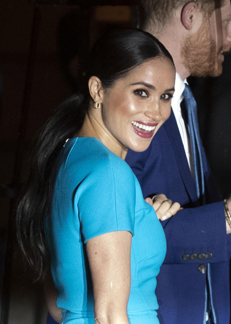 Meghan wore a bright turquoise Victoria Beckham dress for her first post-Megxit appearance. (Photo: Steve Parsons/PA Images via Getty Images)