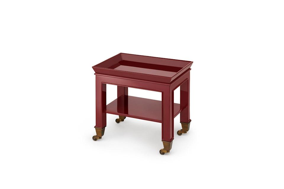 """<p><strong>Miles Redd for The Lacquer Company</strong></p><p>thelacquercompany.com</p><p><a href=""""https://thelacquercompany.com/product/telephone-table/"""" rel=""""nofollow noopener"""" target=""""_blank"""" data-ylk=""""slk:Shop It"""" class=""""link rapid-noclick-resp"""">Shop It</a></p><p>The Telephone Table, designed by Miles Redd for the Lacquer Company, easily moves around on brass casters. Its petite size, whether for a telephone or storing other small items, makes it a perfect piece to always have within arm's reach. </p>"""
