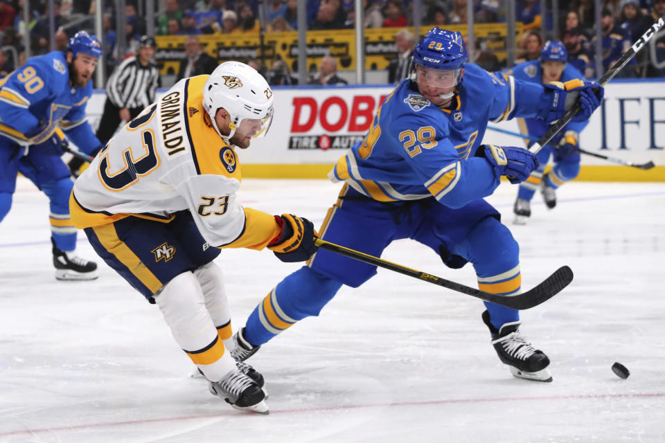 Nashville Predators' Rocco Grimaldi (23) shoots the puck against St. Louis Blues' Vince Dunn (29) during the third period of an NHL hockey game Saturday, Nov. 23, 2019, in St. Louis. (AP Photo/Dilip Vishwanat)
