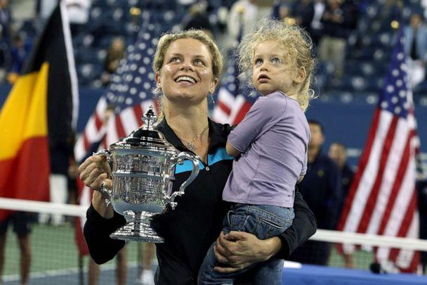 PHOTO: Kim Clijsters of Belgium and daughter Jada pose with the championship trophy after Clijsters defeated Vera Zvonareva of Russia during their women's singles final on day thirteen of the 2010 U.S. Open, Sept. 11, 2010 in New York. (Al Bello/Getty Images)